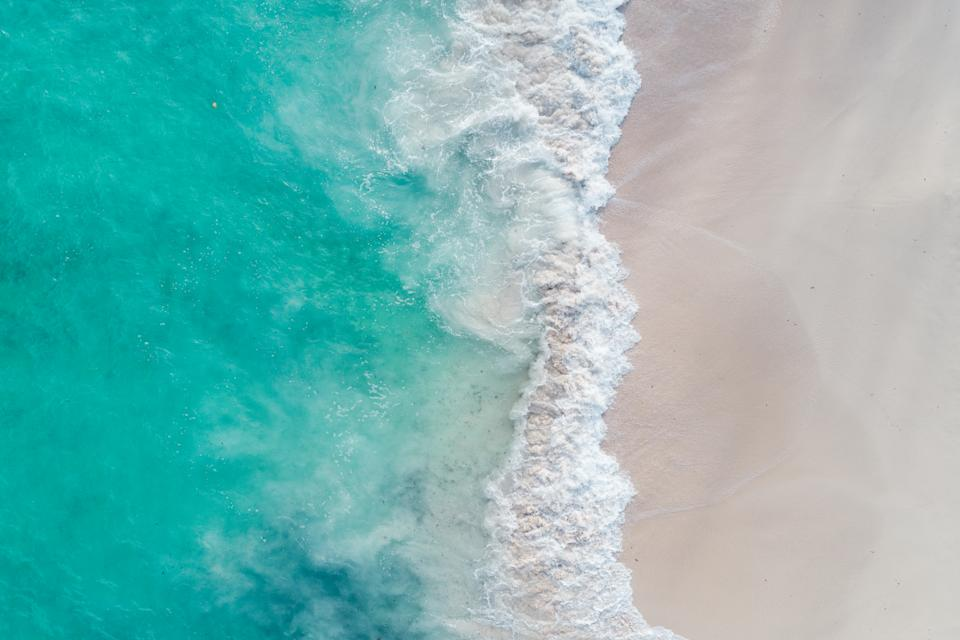 Beach and sea waves shot from above, Barbados