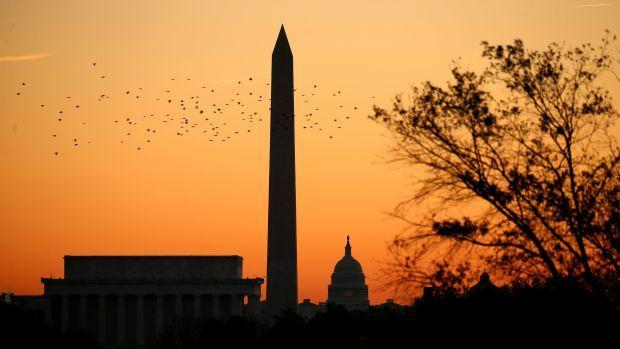 An orange sky over the Washington Monument and the Capitol building in Washington, DC