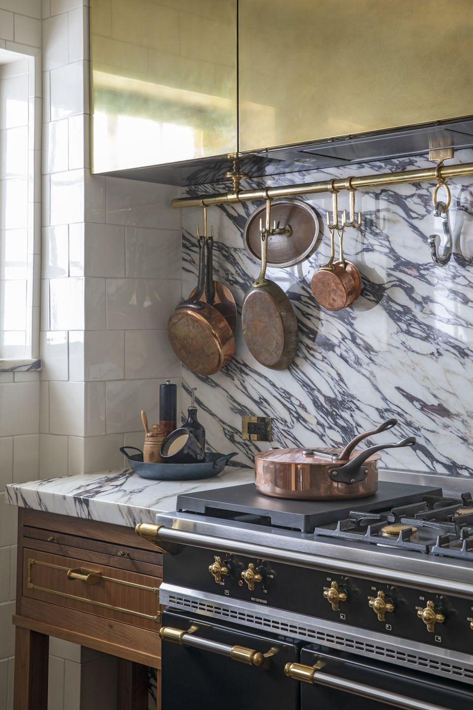 "<p>Not everything has to be put away! You can add appliances that go with the overall look of your kitchen and also <a href=""https://www.housebeautiful.com/lifestyle/organizing-tips/g4436/kitchen-organization-makeover/"" rel=""nofollow noopener"" target=""_blank"" data-ylk=""slk:create extra storage"" class=""link rapid-noclick-resp"">create extra storage</a> for a touch of personality, like <a href=""https://www.housebeautiful.com/design-inspiration/house-tours/a33930928/birgitte-pearce-kitchen-tour/"" rel=""nofollow noopener"" target=""_blank"" data-ylk=""slk:Birgitte Pearce"" class=""link rapid-noclick-resp"">Birgitte Pearce </a>did with copper pots in this kitchen.</p>"
