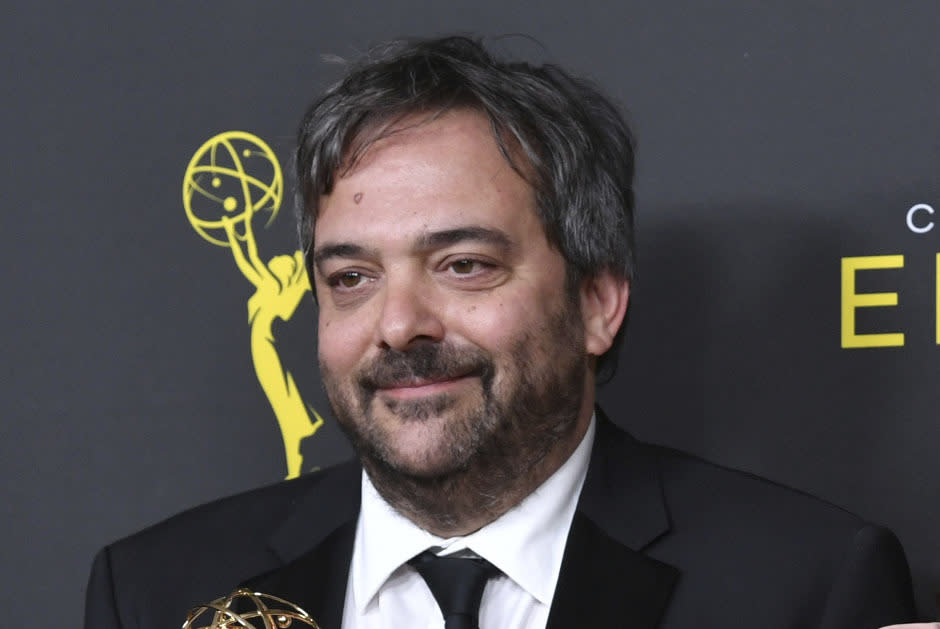 "FILE - This Sept. 14, 2019 file photo shows Adam Schlesinger, winner of the awards for outstanding original music and lyrics for ""Crazy Ex Girlfriend,"" in the press room at the Creative Arts Emmy Awards in Los Angeles. Schlesinger, an Emmy and Grammy winning musician and songwriter known for his band Fountains of Wayne and his songwriting on the TV show ""Crazy Ex-Girlfriend,"" has died from coronavirus at age 51. (Photo by Richard Shotwell/Invision/AP, File)"