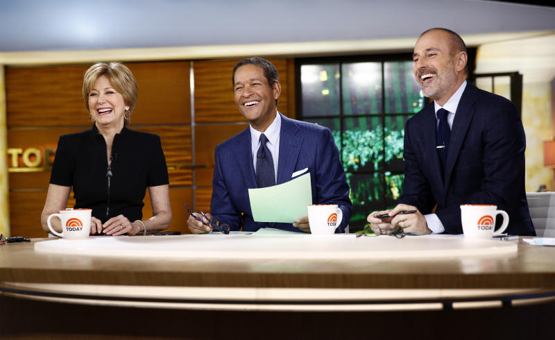 """This image released by NBC shows, from left, guest hosts, Jane Pauley, and Bryant Gumbel with host Matt Lauer on NBC News' """"Today"""" show, Monday, Dec. 30, 2013 in New York. Gumbel and Pauley, who worked together on """"Today"""" from 1982 to 1989, joined Matt Lauer to co-host on Monday, filling in for Savannah Guthrie and Natalie Morales who were off. (AP Photo/NBC, Peter Kramer)"""