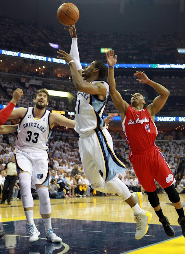 MEMPHIS, TN - MAY 09: Mike Conley #11 of the Memphis Grizzlies shoots the ball against the Los Angeles Clippers in Game Five of the Western Conference Quarterfinals in the 2012 NBA Playoffs at FedExForum on May 9, 2012 in Memphis, Tennessee. NOTE TO USER: User expressly acknowledges and agrees that, by downloading and or using this photograph, User is consenting to the terms and conditions of the Getty Images License Agreement. (Photo by Andy Lyons/Getty Images)