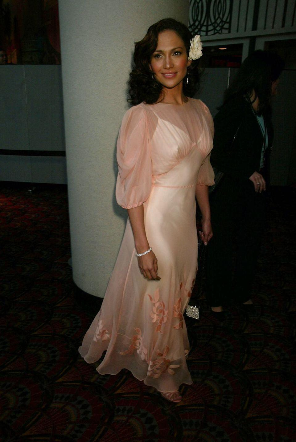 <p>J-Lo went for a pink sheer dress with a cream slip underneath for an NYC premiere. </p>