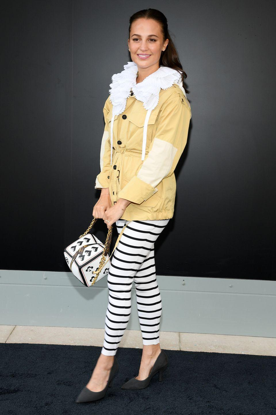<p><strong>6 October </strong>Alicia Vikander styled some striped leggings with a ruffled shirt at the Louis Vuitton show in Paris. </p>