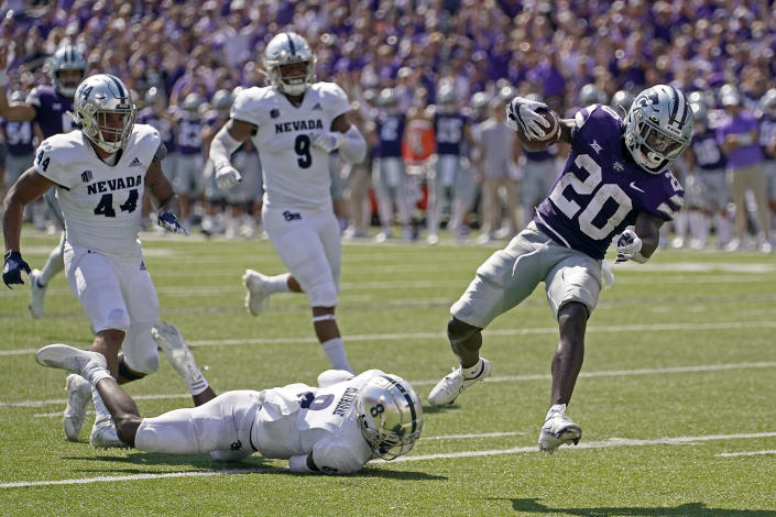 Kansas State running back Joe Ervin (20) runs into the end zone to score a touchdown during the first half of an NCAA college football game against Nevada on Saturday, Sept. 18, 2021, in Manhattan, Kan. (AP Photo/Charlie Riedel)