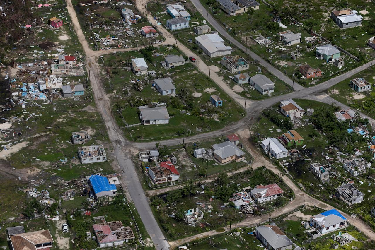 <p>Houses are seen in ruins in Codrington on the island of Barbuda just after a month after Hurricane Irma struck the Caribbean islands of Antigua and Barbuda, October 7, 2017. REUTERS/Shannon Stapleton </p>
