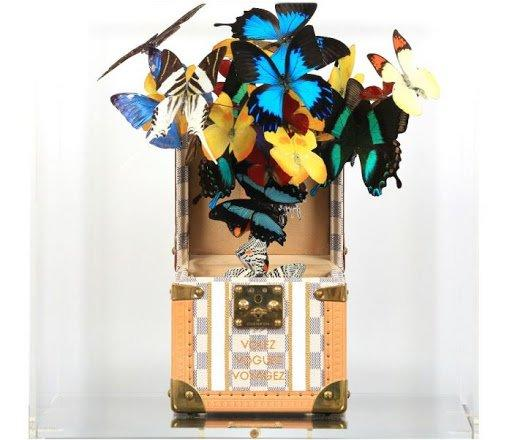 One of several innovative artworks by Roman Feral combining real preserved butterflies with high-end fashion accessories.
