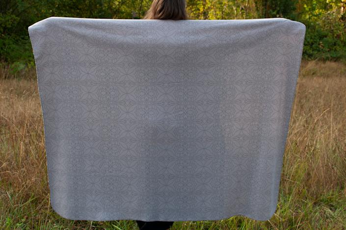 """Being Ojibwe/Cree/Metis, designer Tessa Sayers (Turtle Mountain Chippewa) wanted this sherpa throw featuring modern Ojibwe floral designs to also represent her Pacific Northwest roots since over half of Indigenous people live off the reservation today. Sayers&rsquo; mission to pay tribute to her identity and her journey to self-acceptance influence the collection, and she hopes her story will inspire others to take pride in their roots and individual stories, too.&lt;br&gt;&lt;br&gt;<a href=""""http://www.mysoulcuriosity.com"""" rel=""""nofollow noopener"""" target=""""_blank"""" data-ylk=""""slk:Beyond Buckskin Soul Curiosity Blanket"""" class=""""link rapid-noclick-resp""""><strong>Beyond Buckskin Soul Curiosity Blanket</strong></a><strong>, $65</strong>"""