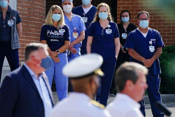 PHOTO: Hamilton Health Care medical staff listen while Brian Kemp, governor of Georgia speaks during a 'Wear A Mask' tour stop in Dalton, Ga., July 2, 2020. (Elijah Nouvelage/Bloomberg via Getty Images)