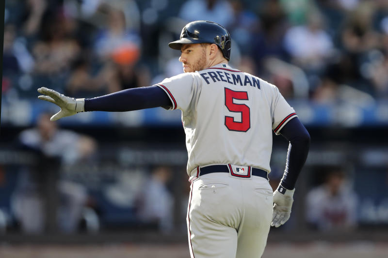 Atlanta Braves' Freddie Freeman waves toward the New York Mets' dugout after he was replaced by a pinch runner after he hit a single during the third inning of a baseball game, Sunday, Sept. 29, 2019, in New York. (AP Photo/Kathy Willens)