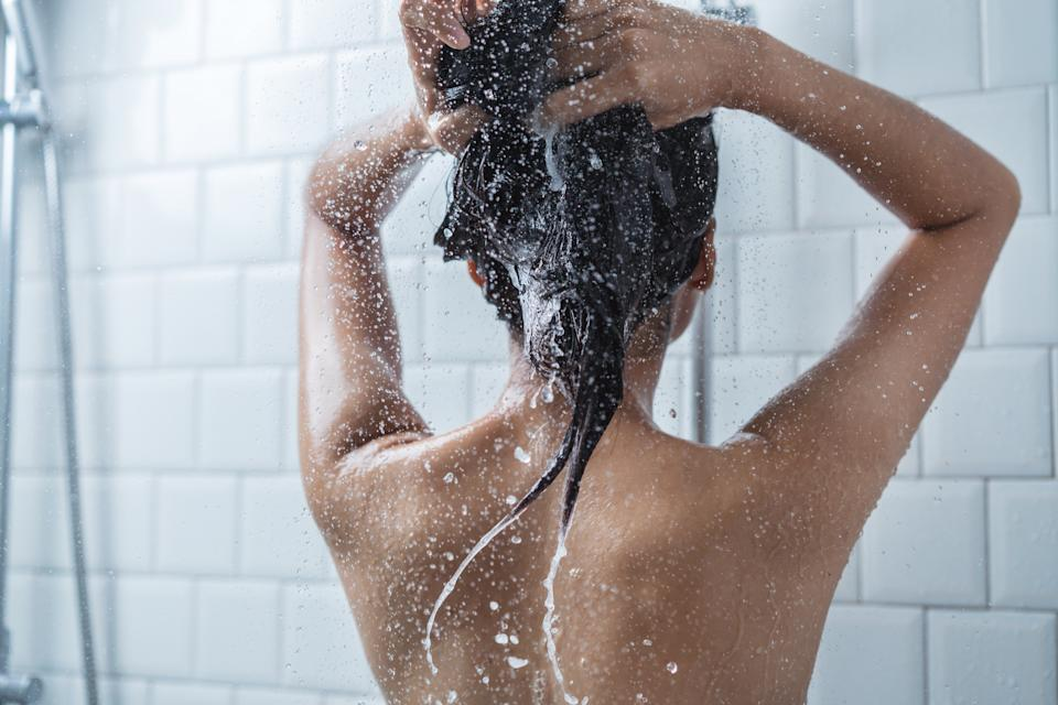 Back view of a woman showering. (PHOTO: Getty Images)