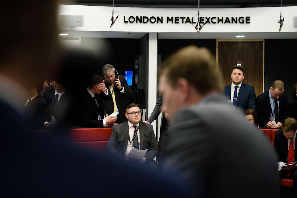 Traders operate in the Ring, the open trading floor of the new London Metal Exchange (LME) in central London on February 18, 2016. The Ring has provided a transparent and robust price-discovery process for the global metals industry for 139 years.  / AFP / LEON NEAL        (Photo credit should read LEON NEAL/AFP via Getty Images)