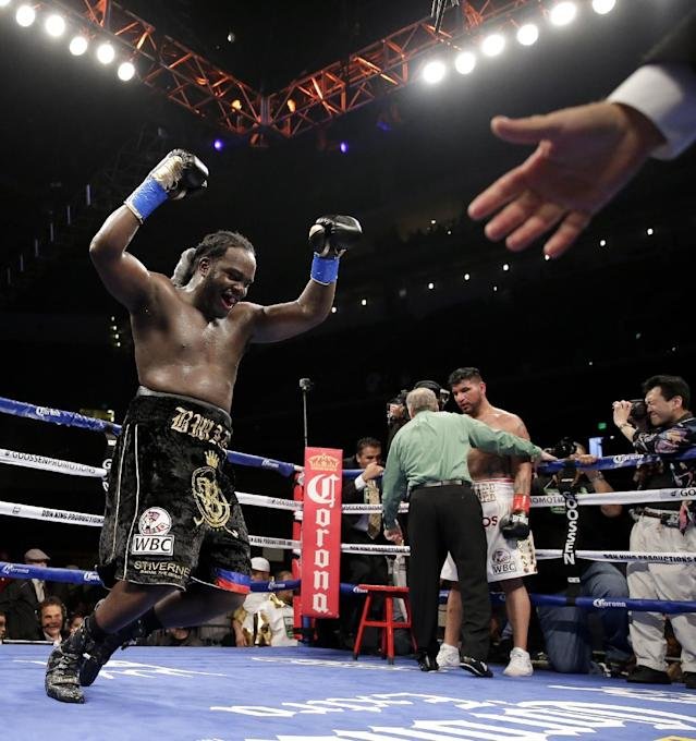 Bermane Stiverne celebrates after referee Jack Reiss stopped his fight against Chris Arreola during their rematch for the WBC heavyweight boxing title in Los Angeles, Saturday, May 10, 2014. Stiverne won the title. (AP Photo/Chris Carlson)