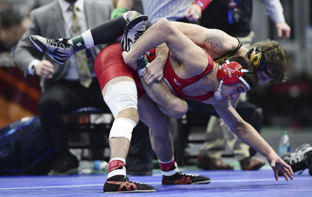 Cornell's Yianni Diakomihalis, bottom, won the 141-pound NCAA title last week with a torn ACL. (AP Photo/David Dermer)