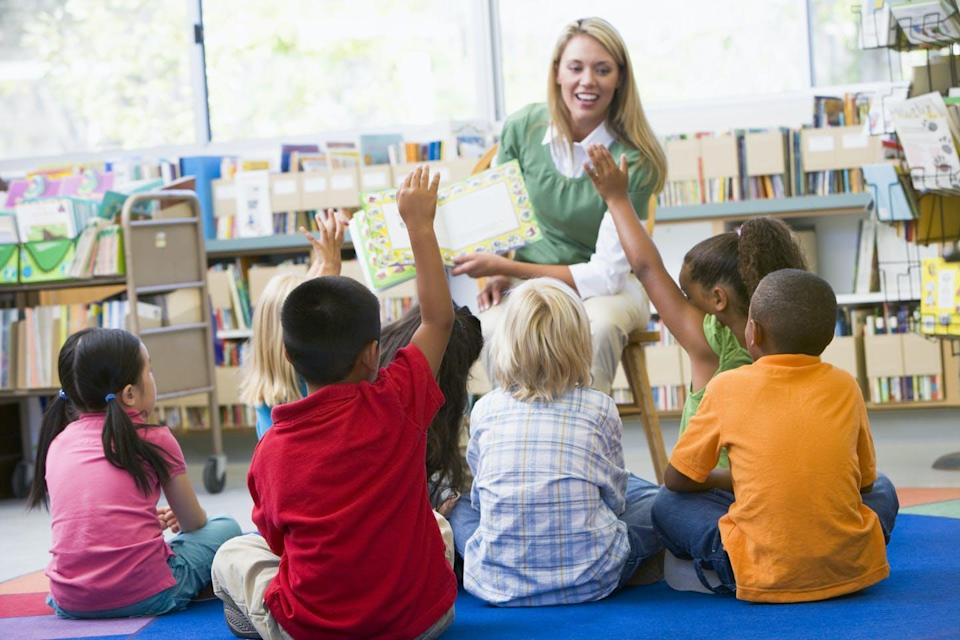 A teacher reads to a group of students