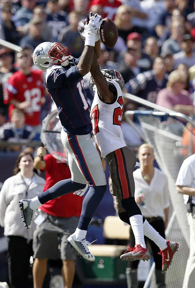 Tampa Bay Buccaneers cornerback Johnthan Banks (27) breaks up a pass intended for New England Patriots wide receiver Aaron Dobson (17) in the first half of an NFL football game Sunday, Sept. 22, 2013, in Foxborough, Mass. (AP Photo/Elise Amendola)