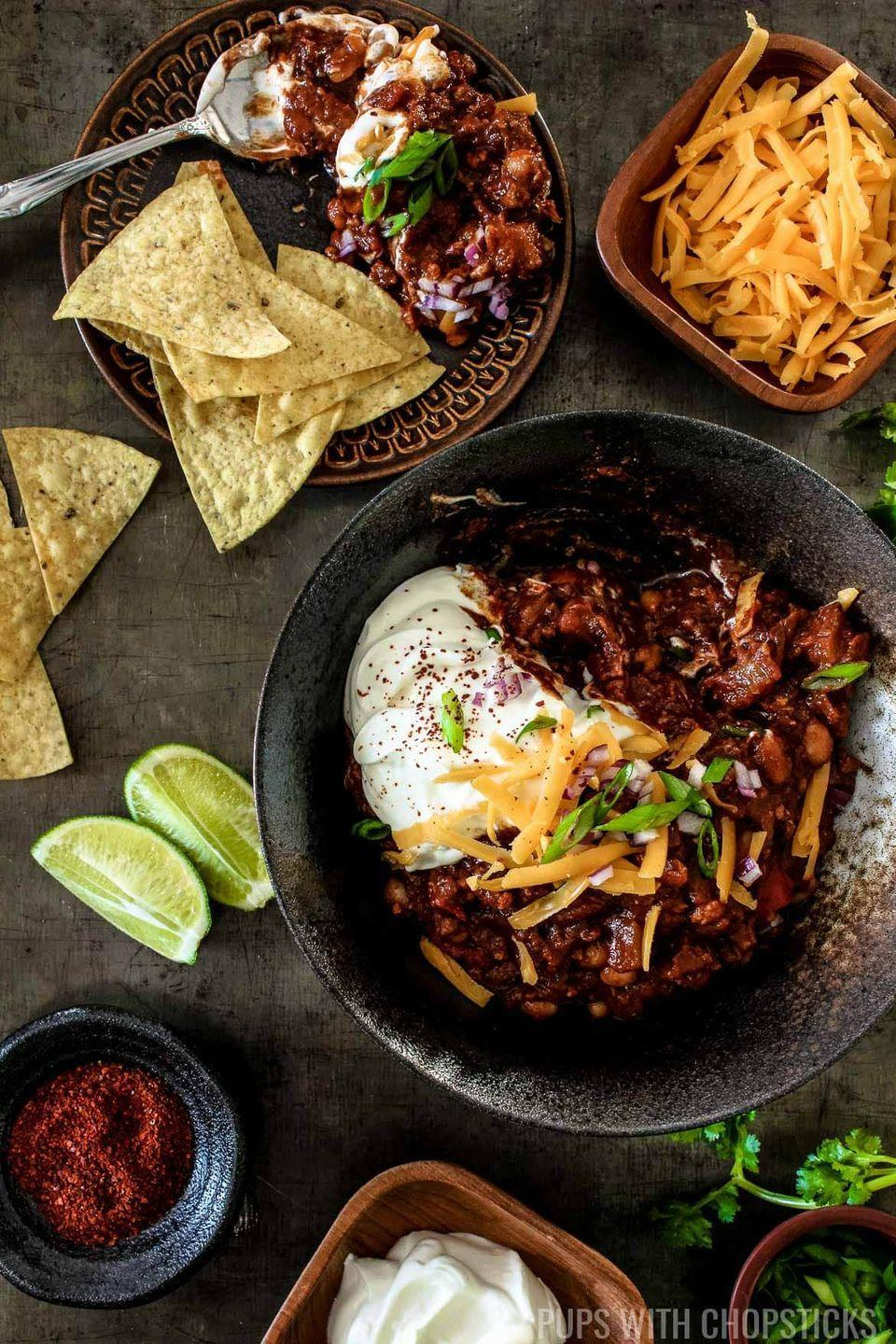 """<p>Along with ground pork, pineapple, and chipotles, this hearty chili gets its deep flavor from a secret ingredient: cocoa powder.</p><p><strong>Get the recipe at <a href=""""https://pupswithchopsticks.com/sweet-smoky-pineapple-chipotle-chili/#recipe"""" rel=""""nofollow noopener"""" target=""""_blank"""" data-ylk=""""slk:Pups with Chopsticks"""" class=""""link rapid-noclick-resp"""">Pups with Chopsticks</a>.</strong></p>"""