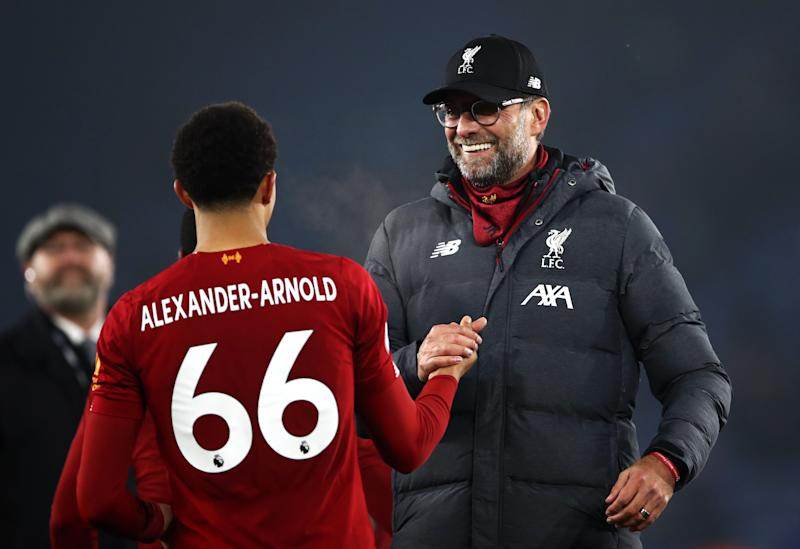 Liverpool manager Jurgen Klopp celebrates victory with Trent Alexander-Arnold after the Premier League match at the King Power Stadium, Leicester. (Photo by Tim Goode/PA Images via Getty Images)