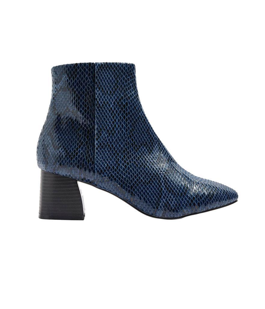 """<p>Featuring a faux-snakeskin exterior in dark royal blue, these just might be the statement boots you've been searching for!<br><a href=""""https://fave.co/2zvGDGY"""" rel=""""nofollow noopener"""" target=""""_blank"""" data-ylk=""""slk:Shop it:"""" class=""""link rapid-noclick-resp"""">Shop it:</a> Babe Ankle Boots, $65, <a href=""""https://fave.co/2zvGDGY"""" rel=""""nofollow noopener"""" target=""""_blank"""" data-ylk=""""slk:topshop.com"""" class=""""link rapid-noclick-resp"""">topshop.com</a> </p>"""