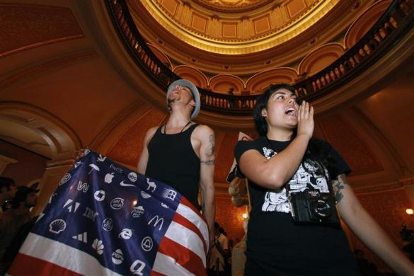 Protesters gather in the Capitol rotunda during the Occupy the Capitol protest in Sacramento, California, March 5, 2012.