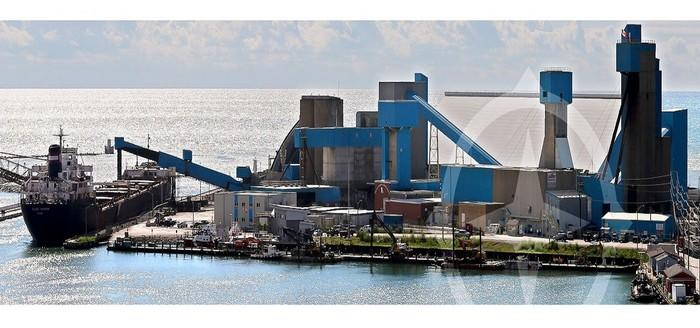 Salt loading and shipment plant, with a ship docked to receive product.