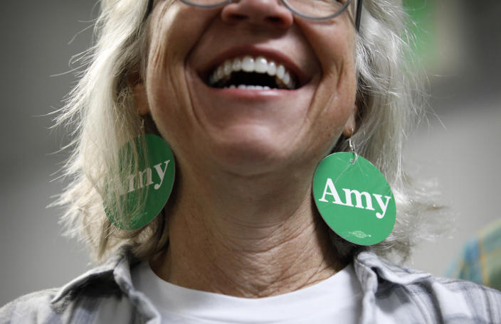 A supporter smiles while listening to Democratic presidential candidate Sen. Amy Klobuchar, D-Minn., at a campaign office, Saturday, Feb. 22, 2020, in Las Vegas. (AP Photo/John Locher)