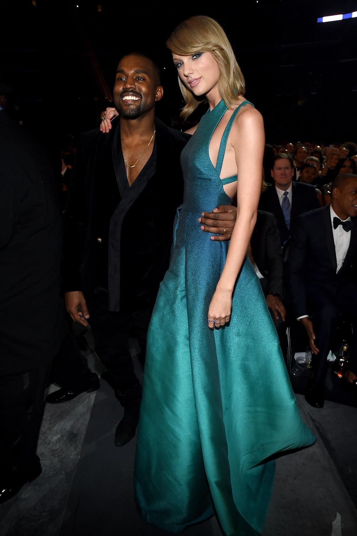 Kanye West and Taylor Swift pose for a photo together at the 2015 Grammys. (Photo: Larry Busacca via Getty Images)
