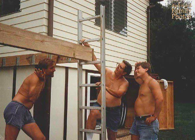 """In 1989 my dad (on the far right) grandfather (holding the ladder) and family friend were building a deck off the back of our house. After they got the first boards up my mother said 'looks nice, but how are you going to get the ladder out?' They forgot to move the ladder before securing the last board for the frame!! They ended up cutting the ladder apart to get it out. Also, notice the awkwardness of the jean shorts."""