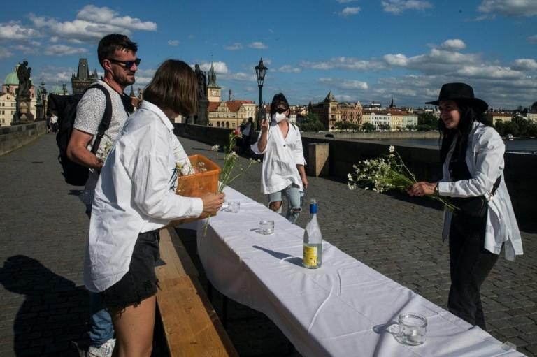 Prague residents celebrated the end of lockdown with a dinner on the city's historic Charles Bridge (AFP Photo/Michal Cizek)
