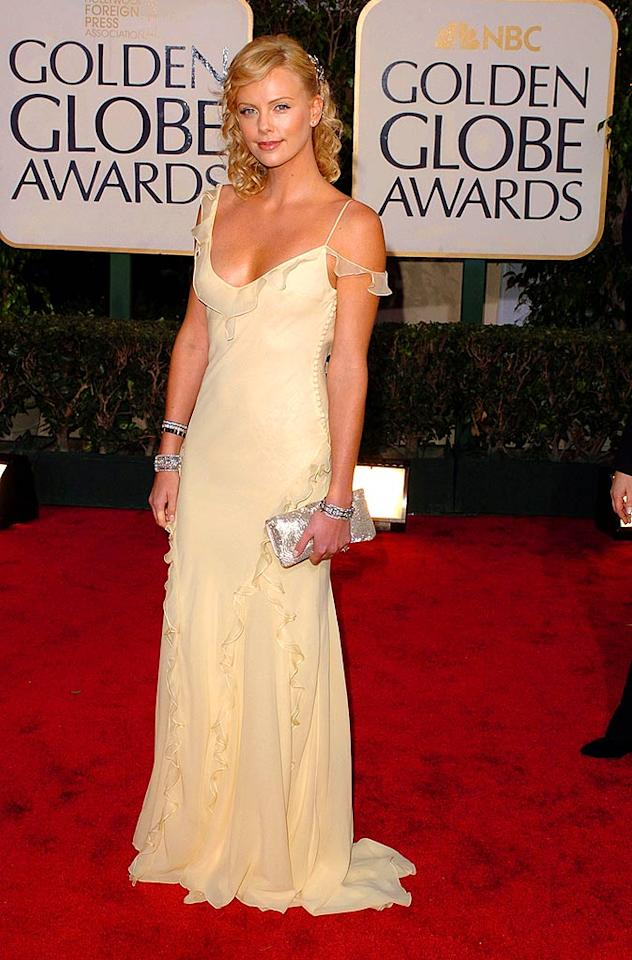 "Before she started abusing the self-bronzer, Charlize Theron could do no wrong on the red carpet, as evidenced by this gorgeous pale yellow dress from 2004. Steve Granitz/<a href=""http://www.wireimage.com"" target=""new"">WireImage.com</a> - January 25, 2004"