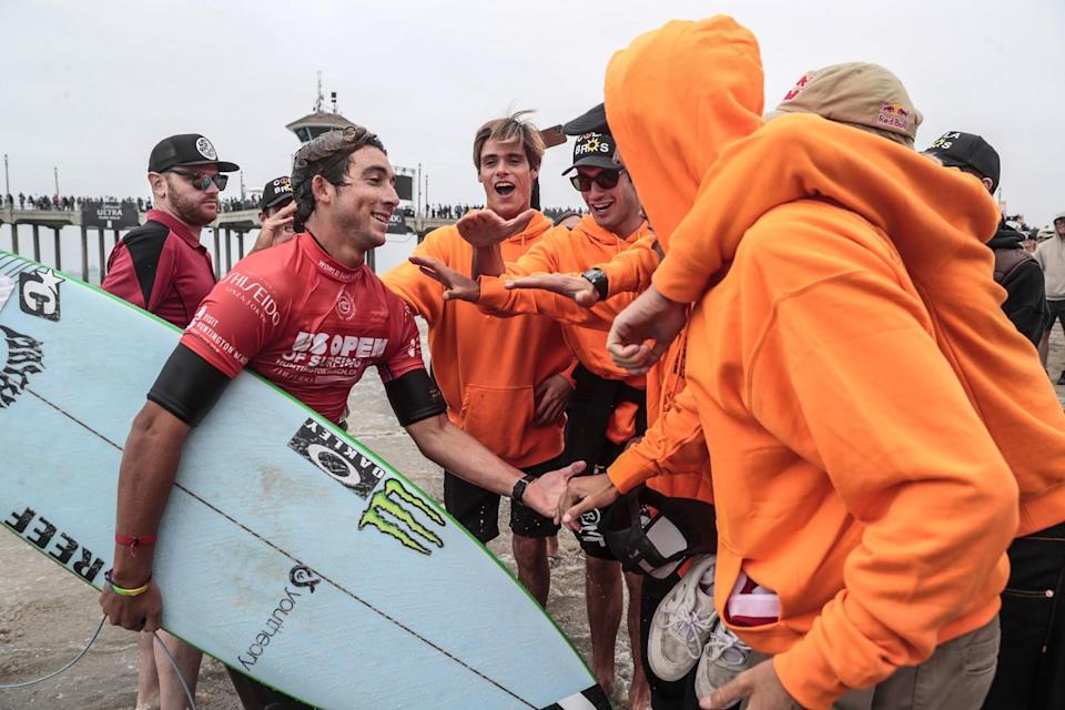 Griffin Colapinto is greeted by friends from San Clemente after he qualified for the finals of the U.S. Open of Surfing