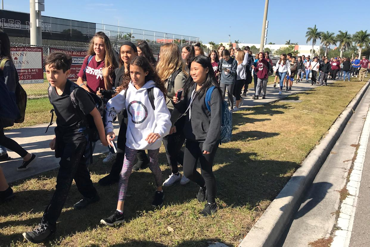 Students walk out at Marjory Stoneman Douglas High School during the National School Walkout to protest gun violence in Parkland, Florida.