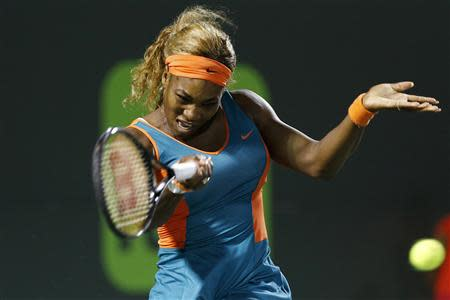 Mar 25, 2014; Miami, FL, USA; Serena Williams hits a forehand against Angelique Kerber (not pictured) on day nine of the Sony Open at Crandon Tennis Center. Williams won 6-2, 6-2. Geoff Burke-USA TODAY Sports