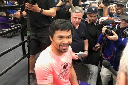 Manny Pacquiao speaks to reporters at Wild Card Boxing Club in Hollywood
