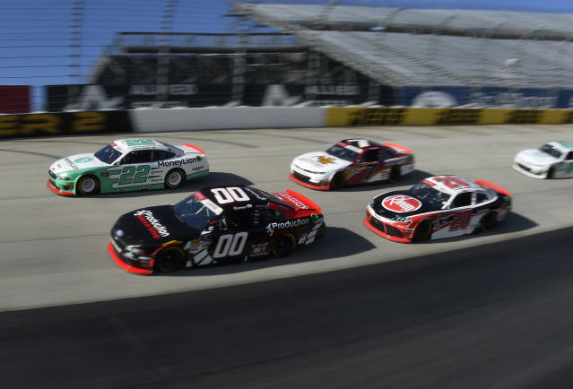 Pole setter Austin Cindric (#22) next to driver Cole Custer (#00) leads the field at the start of the NASCAR Xfinity Series auto race, Saturday, Oct. 5, 2019, in Dover, Del. (AP Photo/Brien Aho)