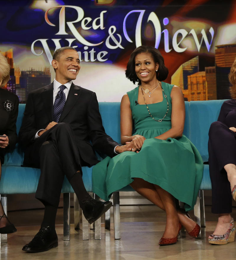 """President Barack Obama and first lady Michelle Obama appear on the ABC Television show """"The View"""" in New York, Monday, Sept. 24, 2012. (AP Photo/Pablo Martinez Monsivais)"""
