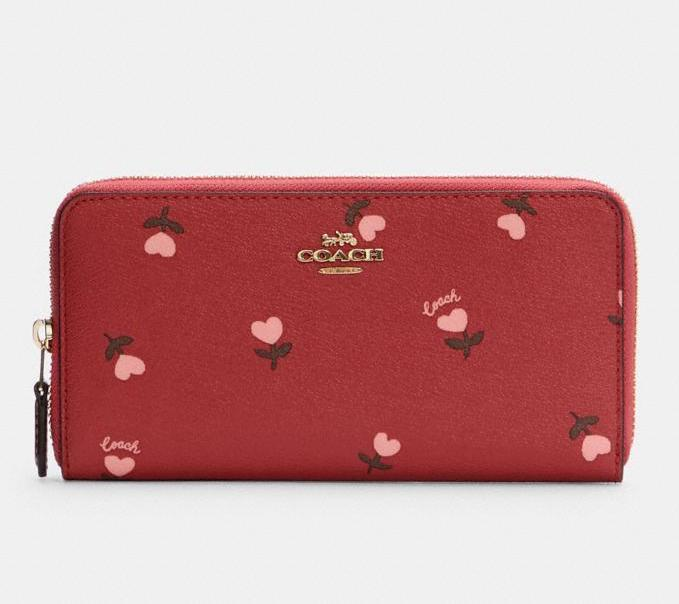 Accordion Zip Wallet With Heart Floral Print. Image via Coach Outlet.