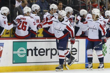 Mar 19, 2019; Newark, NJ, USA; Washington Capitals right wing Brett Connolly (10) celebrates with teammates after scoring a goal against the New Jersey Devils during the second period at Prudential Center. Mandatory Credit: Noah K. Murray-USA TODAY Sports