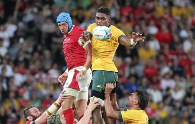 Wales Justin Tipuric, left, and Australia's Isi Naisarani jump to win a lineout ball during the Rugby World Cup Pool D game at Tokyo Stadium between Australia and Wales in Tokyo, Japan, Sunday, Sept. 29, 2019. (AP Photo/Koji Sasahara)