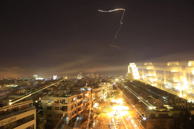 <p>Damascus is seen as the U.S. launches an attack on Syria targeting different parts of the capital early Saturday, April 14, 2018. Syria's capital has been rocked by loud explosions that lit up the sky with heavy smoke as U.S. President Donald Trump announced airstrikes in retaliation for the country's alleged use of chemical weapons. (Photo: Hassan Ammar/AP) </p>