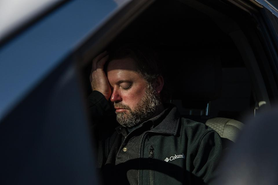 Mike Kurtz sits in his truck to decompress for a few minutes after working more than 10 hours. (Photo: Ariana Drehsler for HuffPost)