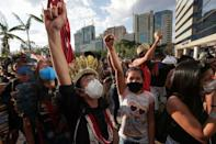 Indigenous Brazilians take part in a protest to defend the demarcation of indigenous lands, in Brasilia