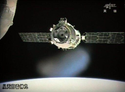 The Shenzhou-9 spacecraft linked with the Tiangong-1 module just over a week into a manned space mission