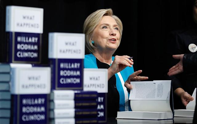 Former Secretary of State Hillary Clinton signs copies of her new book, <em>What Happened</em>, at Barnes & Noble Union Square on Tuesday in New York City. (Photo by John Lamparski/Getty Images)