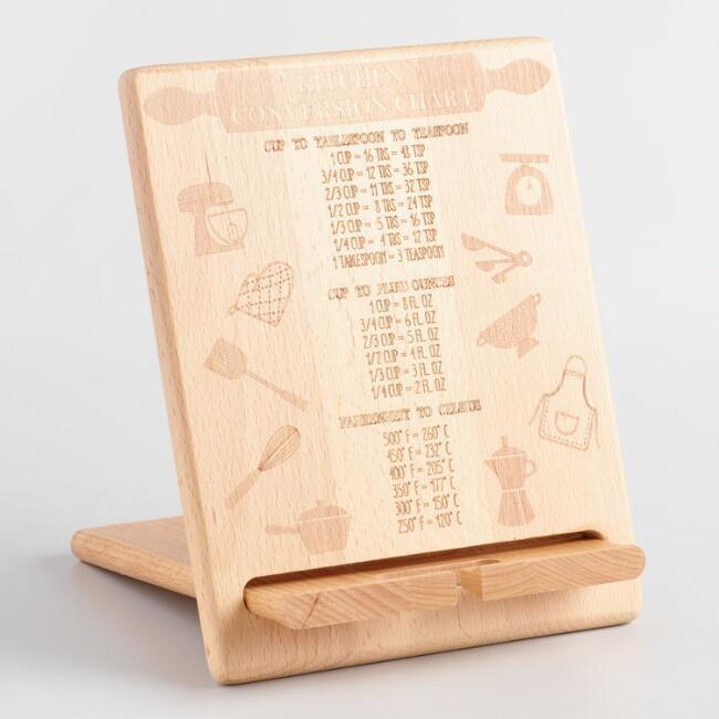"""<p>If you're cooking from an iPad, this wooden stand will hold it upright. And hidden behind it is a chart that'll tell you exactly how many tablespoons, teaspoons, and ounces are in a cup.</p><p><strong><em>BUY IT NOW: Kitchen Conversion Chart Wood Tablet Stand, $25; </em></strong><a href=""""https://www.worldmarket.com/product/kitchen-conversion-chart-wood-tablet-stand.do?sortby=newArrivalsDescend&page=10&from=fn"""" rel=""""nofollow noopener"""" target=""""_blank"""" data-ylk=""""slk:Worldmarket.com"""" class=""""link rapid-noclick-resp""""><strong><em>Worldmarket.com</em></strong></a></p>"""