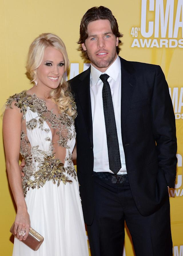 NASHVILLE, TN - NOVEMBER 01: Country music artist Carrie Underwood and hockey player Mike Fisher attend the 46th annual CMA Awards at the Bridgestone Arena on November 1, 2012 in Nashville, Tennessee. (Photo by Jason Kempin/Getty Images)