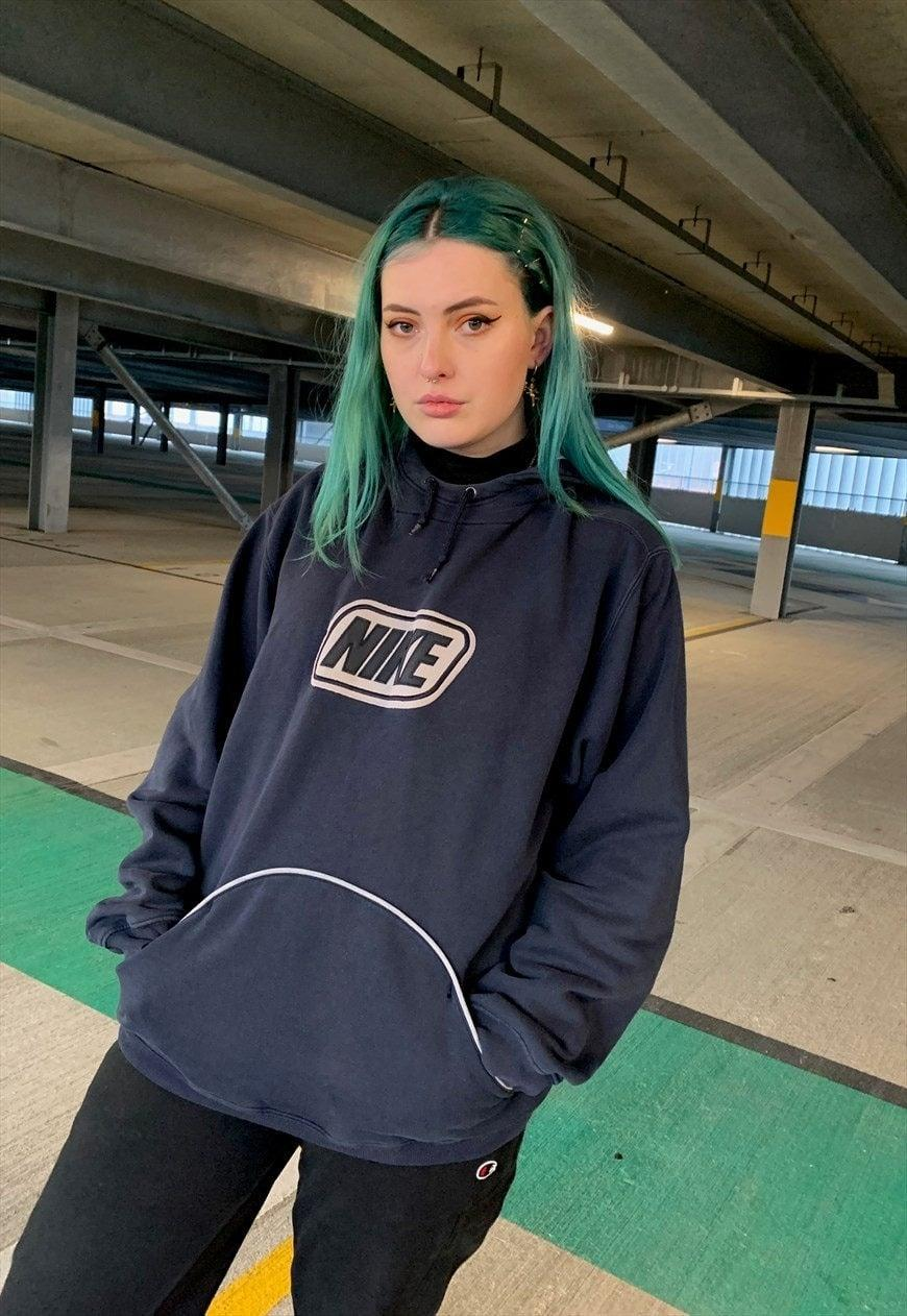 "<br><br><strong>Nike</strong> 90s Navy Embroidered Spellout Hoodie, $, available at <a href=""https://marketplace.asos.com/listing/hoodies/vintage-nike-90s-navy-embroidered-spellout-hoodie/6195676"" rel=""nofollow noopener"" target=""_blank"" data-ylk=""slk:asos marketplace"" class=""link rapid-noclick-resp"">asos marketplace</a>"