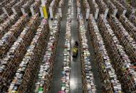FILE PHOTO: Worker gathers items for delivery at Amazon's distribution center in Phoenix