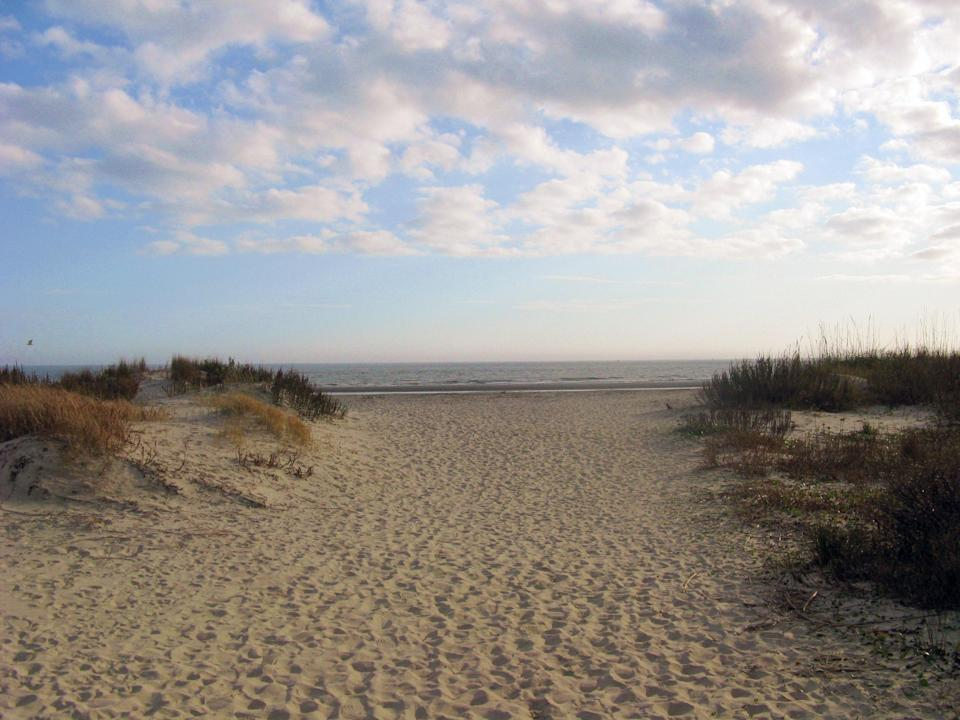 """<p><strong>Give us the wide-angle view: what kind of beach are we talking about?</strong><br> Though it's pretty quiet in the off-season, the beach at Sullivan's Island is a hive of activity come spring and summer. Driving out of downtown Charleston across the Ravenel Bridge, marsh and wetlands give way to this lovely barrier island, with its public beach overlooked by the historic lighthouse. Come at low tide, when the sands are wide enough to accommodate the throngs of day trippers trickling in from the city.</p> <p><strong>How accessible is it?</strong><br> It's car-accessible, and just a 15-20 minute drive from the peninsula. You can park anywhere you can back onto the sands (there are beach access points approximately once per block), but get there before 10 a.m. during high season if you want to avoid a veritable scrum of vehicles.</p> <p><strong>Decent services and facilities, would you say?</strong><br> There aren't really any beachside amenities, but the fact that the environs aren't overdeveloped is part of Sullivan's appeal. Don't count on privacy: you can sneak off behind a dune if you need to, but otherwise, plan on bringing (and wearing) everything you might need for a day at the beach. And if that plan includes Fido, note there will be some pre-planning involved. <a href=""""https://sullivansisland.sc.gov/dog-licenses"""" rel=""""nofollow noopener"""" target=""""_blank"""" data-ylk=""""slk:All dogs must have a license from Town Hall (including residents, visitors and day-trippers) and comply with the Animal and Fowl Ordinance."""" class=""""link rapid-noclick-resp"""">All dogs must have a license from Town Hall (including residents, visitors and day-trippers) and comply with the Animal and Fowl Ordinance.</a></p> <p><strong>How's the actual beach stuff—sand and surf?</strong><br> Most people come here to just chill on the sand, but the swell does get respectable enough for some surfing; if you're lucky, the breeze might even pick up enough to kite surf. It's also worth noting how """