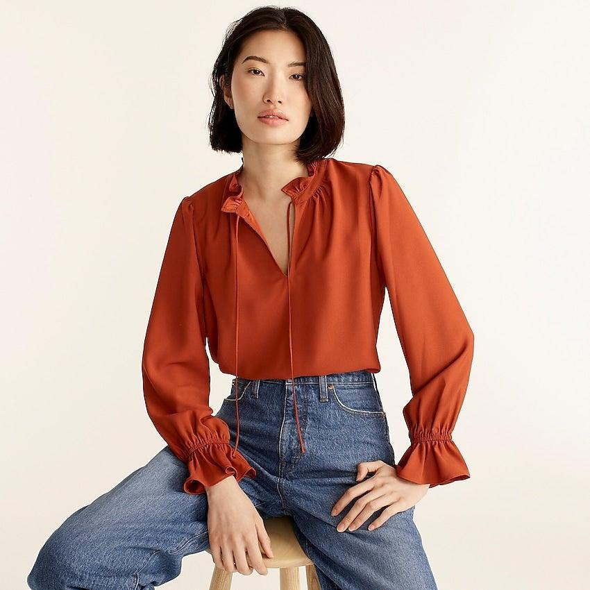 """<br><br><strong>J. Crew</strong> Gathered ruffle drapey top, $, available at <a href=""""https://go.skimresources.com/?id=30283X879131&url=https%3A%2F%2Fwww.jcrew.com%2Fp%2Fwomens%2Fcategories%2Fclothing%2Fshirts-and-tops%2Fgathered-ruffle-drapey-top%2FBC959%3Fdisplay%3Dstandard%26fit%3DClassic%26color_name%3Ddeep-ember%26colorProductCode%3DBC959"""" rel=""""nofollow noopener"""" target=""""_blank"""" data-ylk=""""slk:J. Crew"""" class=""""link rapid-noclick-resp"""">J. Crew</a>"""